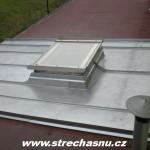 rozvodí na plechové střeše Brno